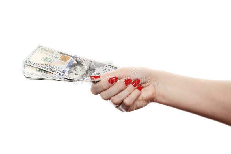 Рука при деньги изолированные на белой предпосылке стоковое изображение