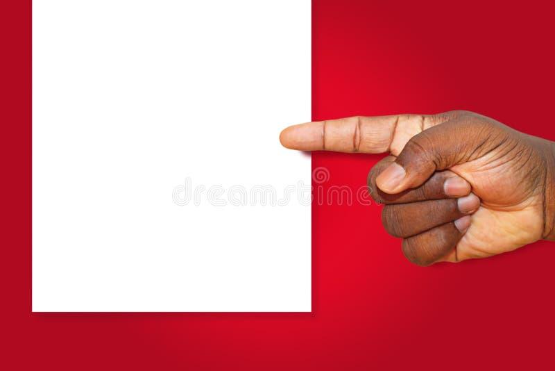 Рука указывая на пустой белый шаблон знака - космос экземпляра стоковое изображение