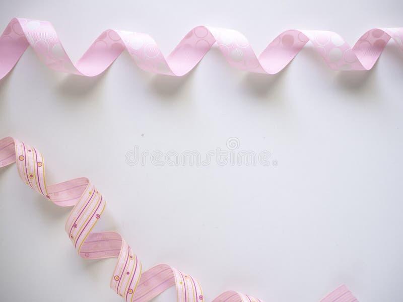 Розовая курчавая лента на белом стоковая фотография rf