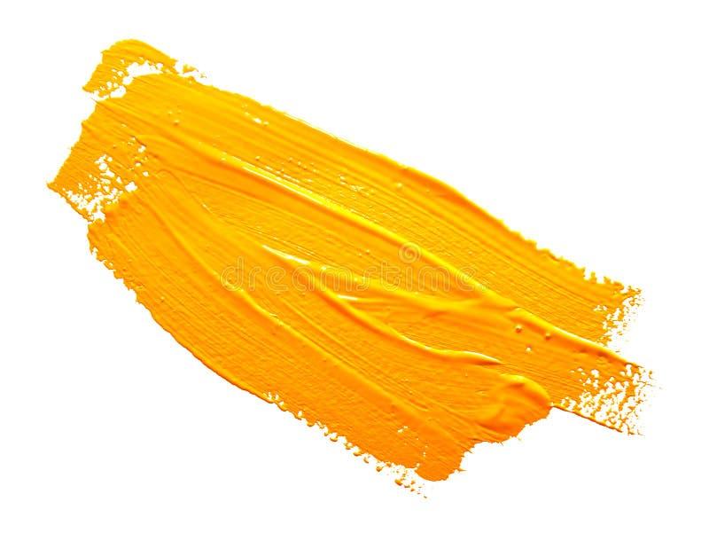 Żółci uderzenia farby muśnięcie odizolowywający fotografia stock