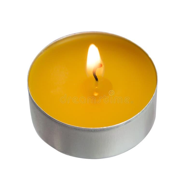 Żółta świeczka odizolowywająca na białym tle obraz stock