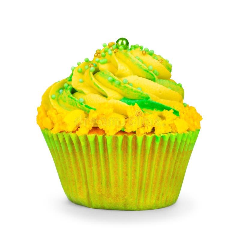 Żółta urodzinowa babeczka z zieloną śmietanką fotografia stock