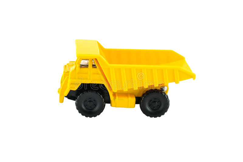 Żółta usypu samochodu zabawka obraz stock