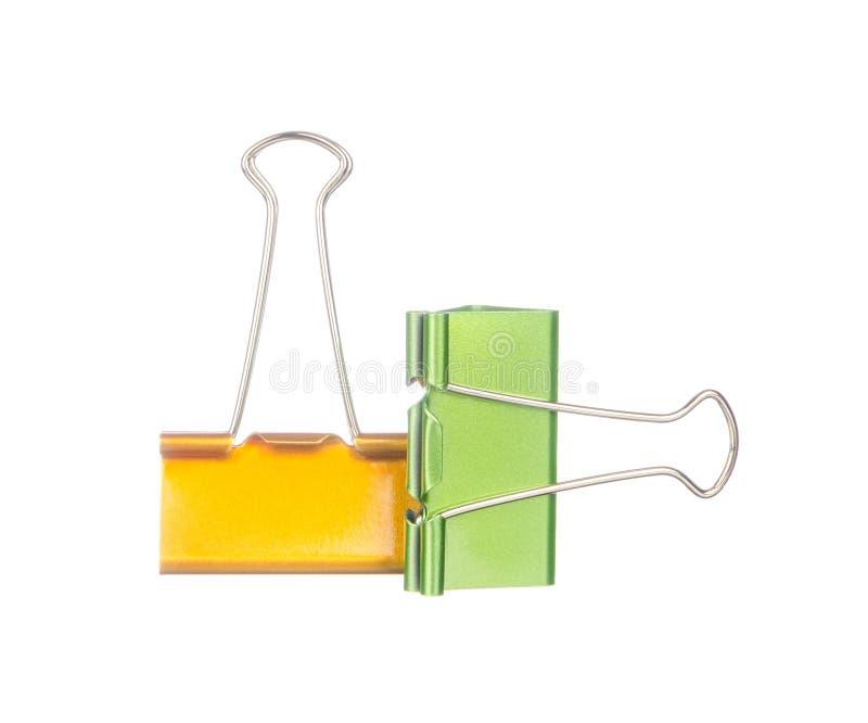 Żółte i zielone papierowe klamerki odizolowywać na bielu obrazy stock