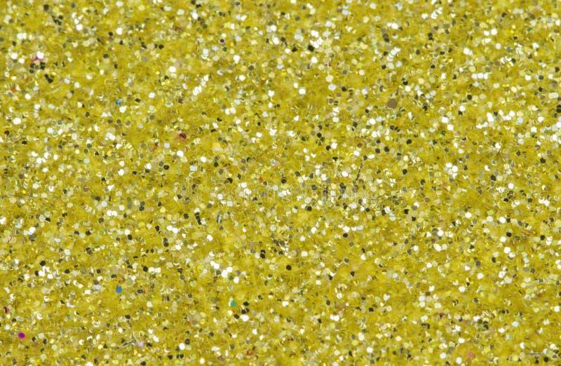 Żółty abstrakcjonistyczny tło Złocista błyskotliwości zbliżenia fotografia Złotego shimmer opakunkowy papier obraz royalty free