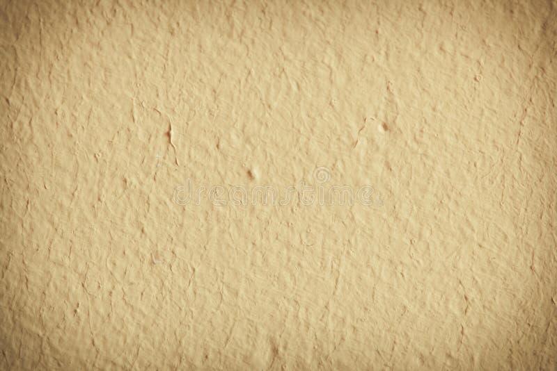 Żółty farby betonowej ściany tło lub tekstura fotografia royalty free