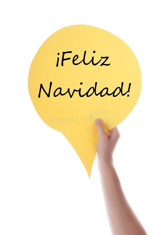 Żółty mowa balon Z Feliz Navidad obraz stock