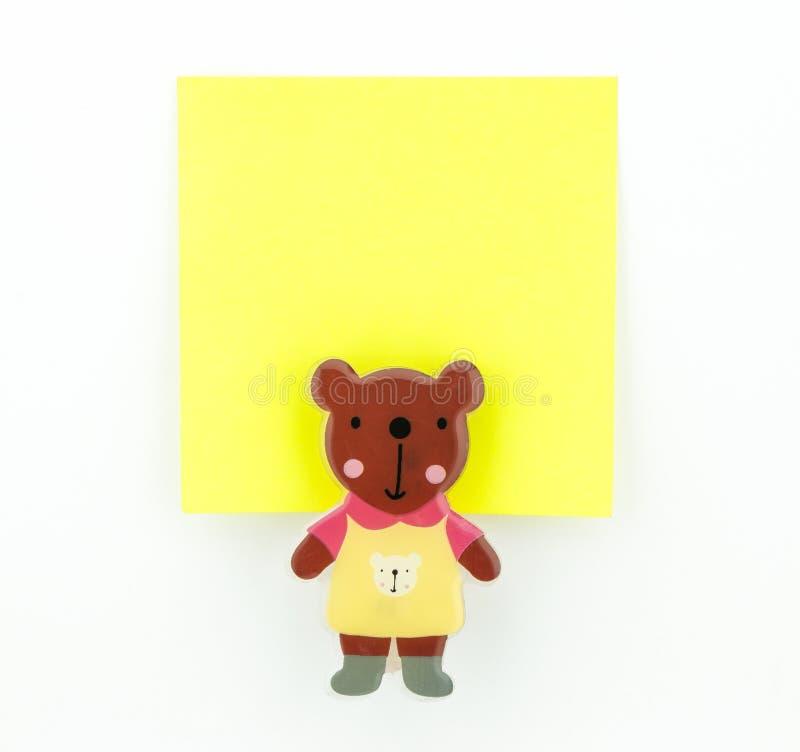 Żółty nutowy ochraniacz z niedźwiadkową klamerką fotografia stock