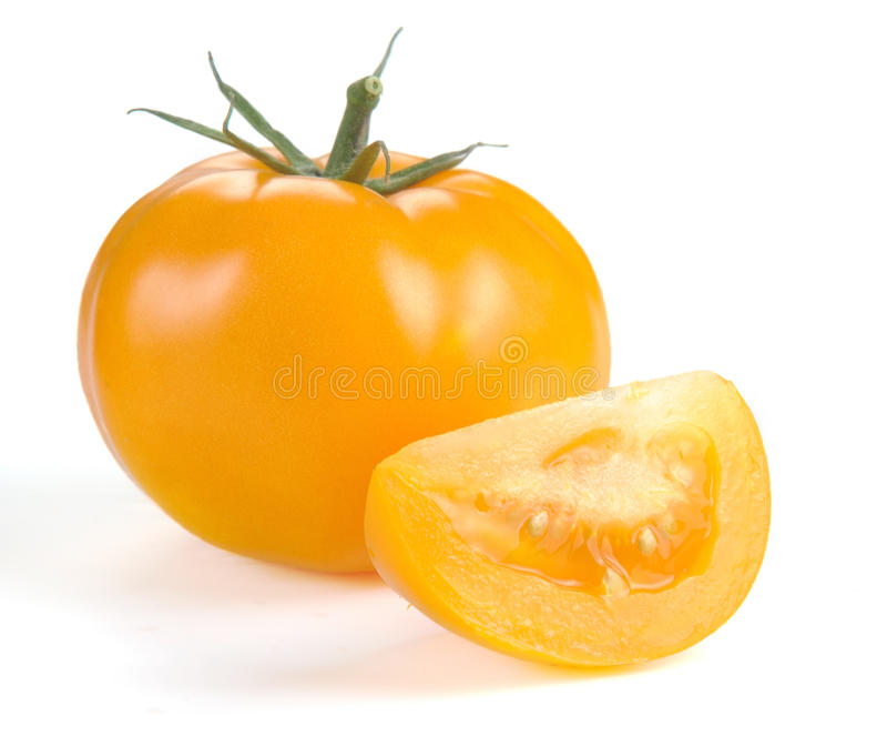 Żółty pomidor z plasterkami obraz royalty free