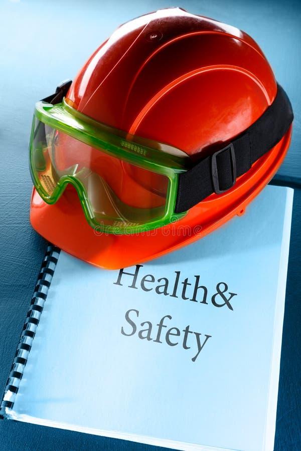 Óculos de proteção e capacete vermelho fotografia de stock royalty free