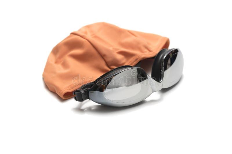 Óculos de proteção e toalha da natação foto de stock