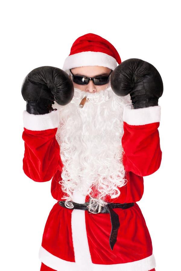 Óculos de sol desgastando de Papai Noel com luva de encaixotamento imagem de stock