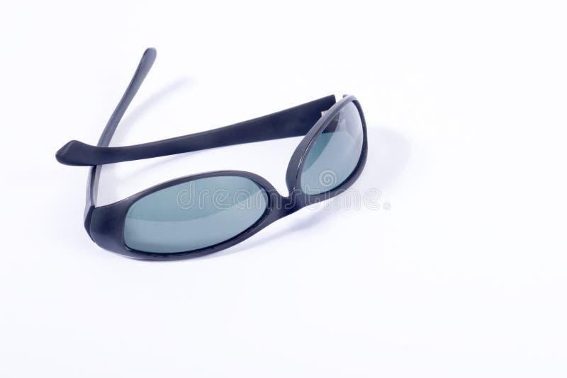 Óculos de sol no branco fotografia de stock royalty free