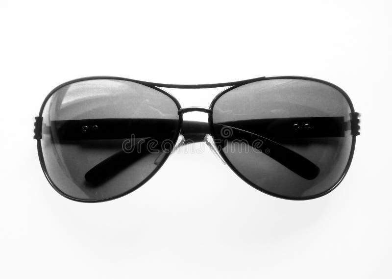 Óculos de sol pretos em um fundo branco foto de stock royalty free