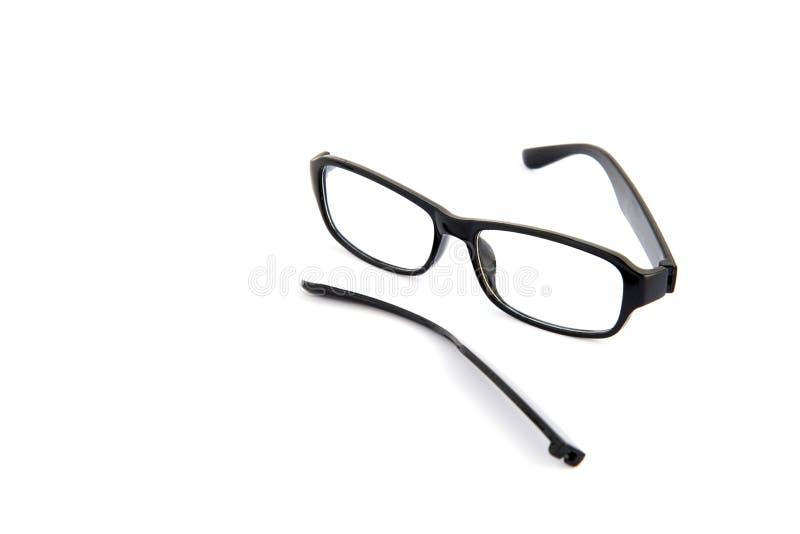 Óculos oculares quebrados, isolados sobre fundo branco Quadro celuloide preto fotos de stock