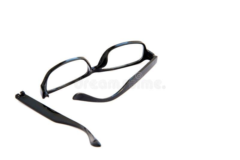 Óculos oculares quebrados, isolados sobre fundo branco Quadro celuloide preto foto de stock royalty free