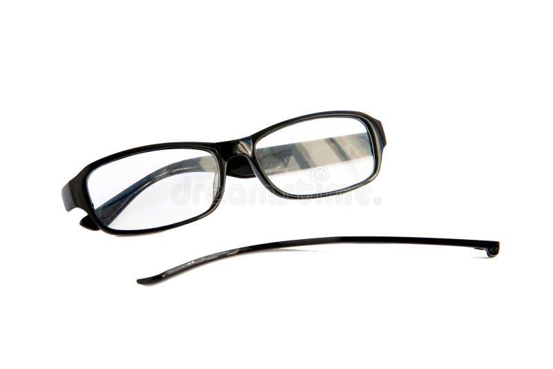Óculos oculares quebrados, isolados sobre fundo branco Quadro celuloide preto Sorriso de dor imagens de stock royalty free