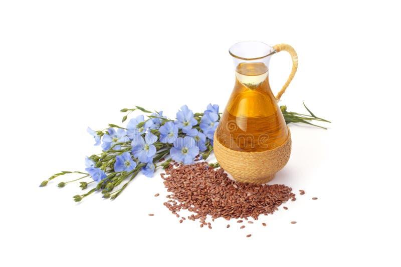 Óleo de linhaça com sementes de linho fotografia de stock