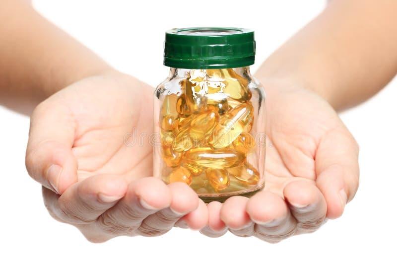 Óleo de peixes da vitamina fotografia de stock royalty free