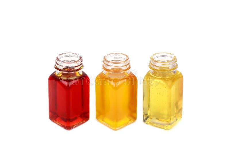 Óleo de rícino, óleo do rosehip e óleo de mostarda no fundo branco fotos de stock royalty free