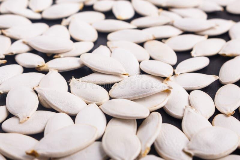 Óleo de semente da abóbora em um fundo rústico fotos de stock royalty free
