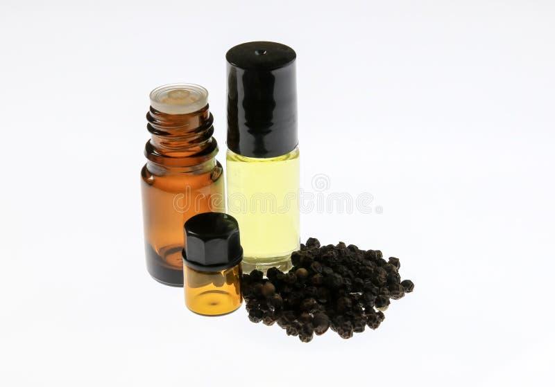 Óleo essencial de pimenta preta foto de stock royalty free