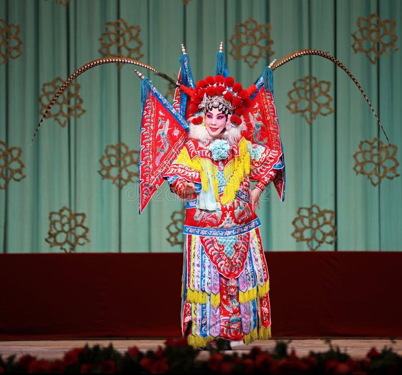 Ópera de Peking - o cavalo de galope de cabelo vermelho fotos de stock royalty free
