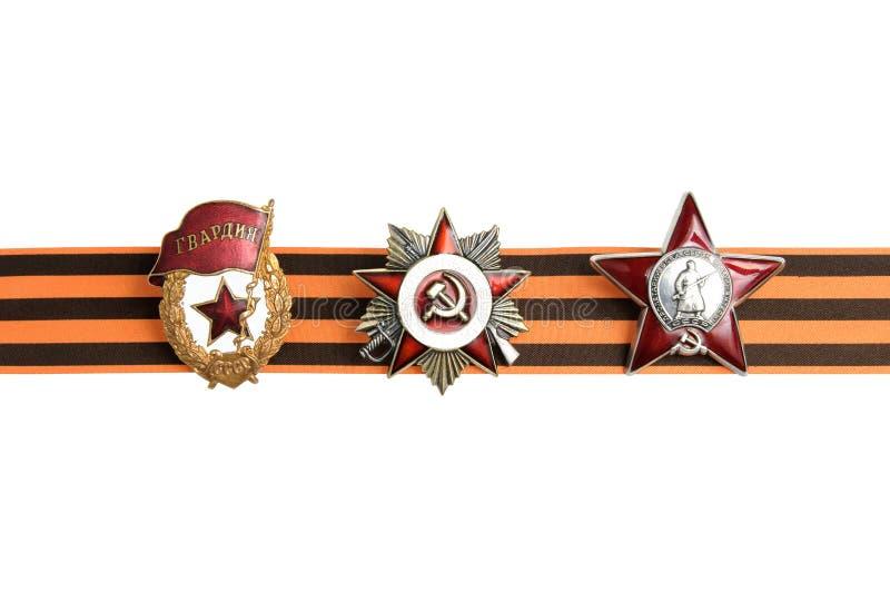 Órdenes soviéticas de la gran guerra patriótica en la cinta de San Jorge como frontera horizontal imagen de archivo