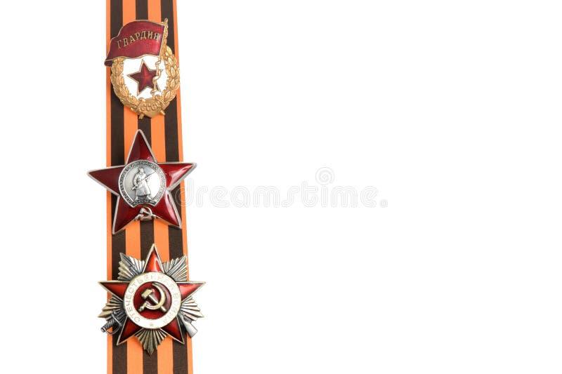 Órdenes soviéticas de la gran guerra patriótica en la cinta de San Jorge como frontera vertical foto de archivo libre de regalías