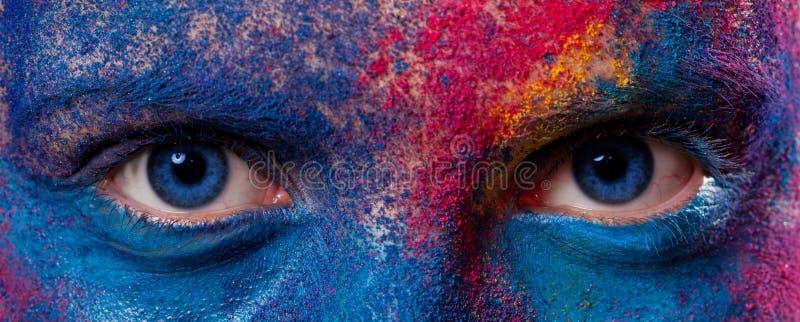 Ögon av kvinnan med målarfärgsmink royaltyfria bilder