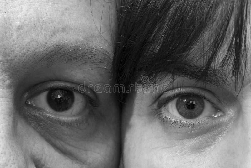 Ögonen av en kvinna och en man royaltyfri foto