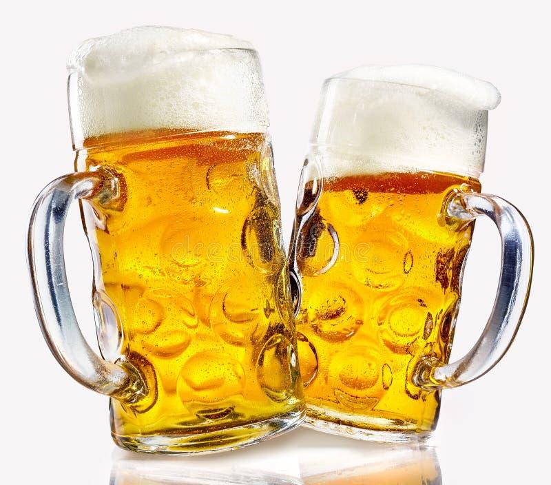 Öl för två exponeringsglas rånar mycket av guld- lager royaltyfri fotografi