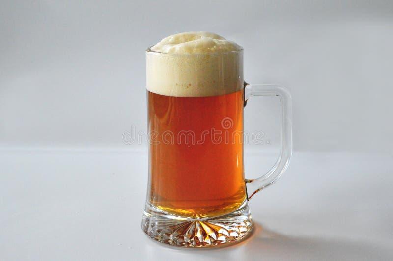 Öl in i ett exponeringsglas arkivfoton