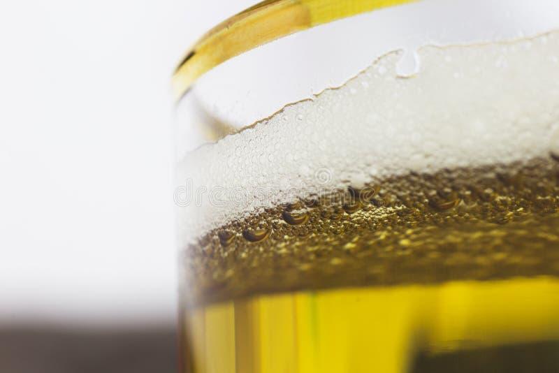Öl i exponeringsglaset royaltyfri fotografi