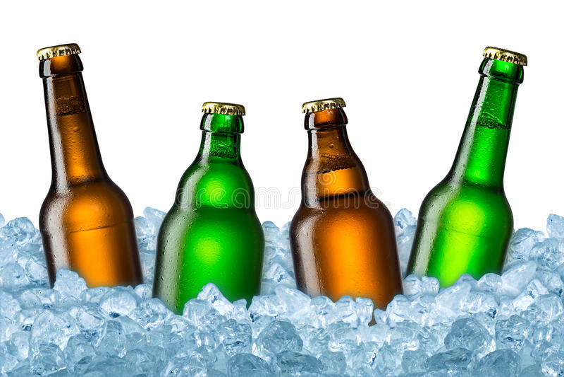Ölflaskor på is royaltyfri bild