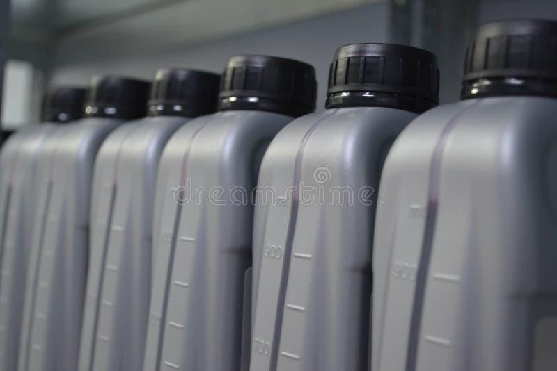 Ölkanister Auto-Teile Motoröl stockbild