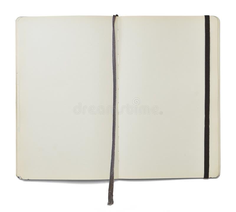 Öppen anmärkningsbok för mellanrum med en bokmärke och en elastisk stängning fotografering för bildbyråer