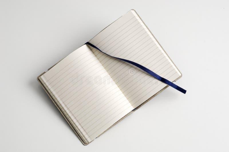 öppen anteckningsbok arkivfoton