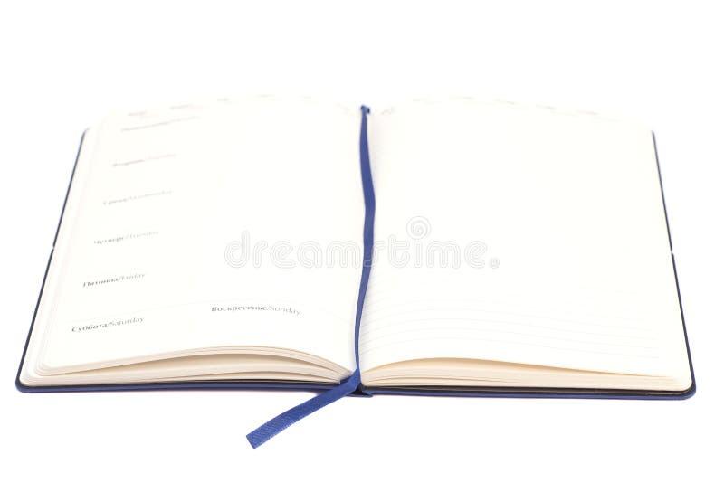 öppen anteckningsbok royaltyfria foton
