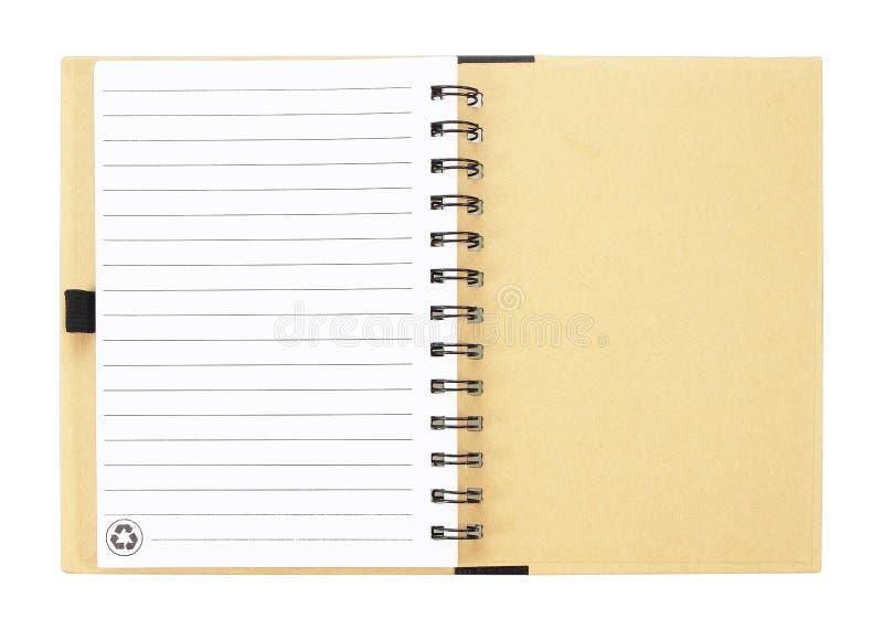 Öppen anteckningsbok med vit fodrade sidor som isoleras på vit backgroun royaltyfri fotografi