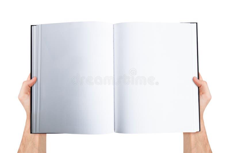 Öppen bok för handinnehavmellanrum arkivbilder