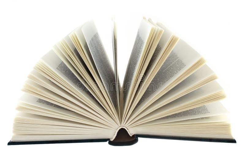 Öppen bok på det vita bakgrundsslutet upp arkivfoto