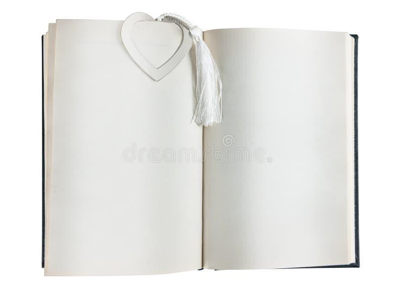 öppen bokbokmärkehjärta arkivfoto