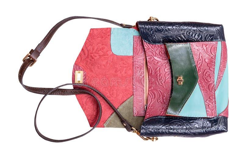 Öppen patchwork utföra i relief isolerad läderhandväska arkivfoton