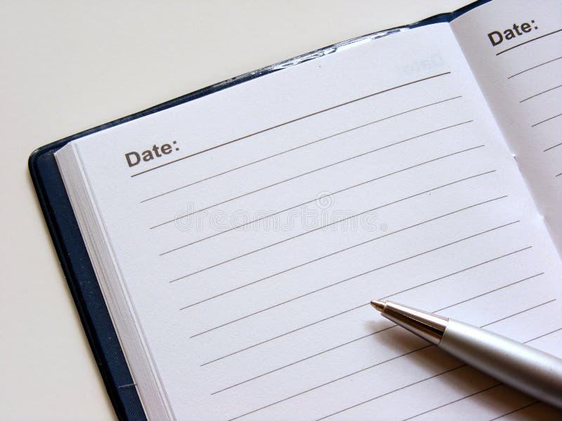 öppen penna för dagbok royaltyfria bilder