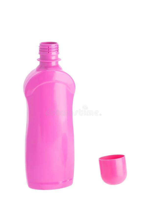 Öppen rosa flaska med lokalvård och det desinficera medlet som isoleras på vit royaltyfri fotografi