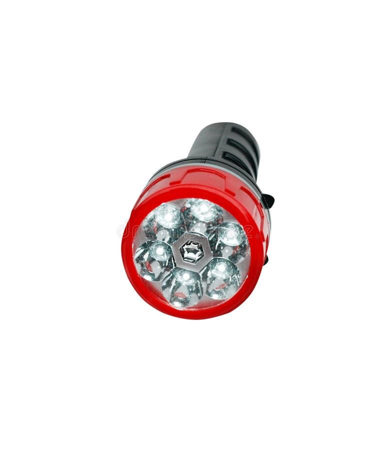 Öppen svart plast- ficklampa med den röda kanten i horisontal som isoleras på vit bakgrund med urklippbanan arkivfoto