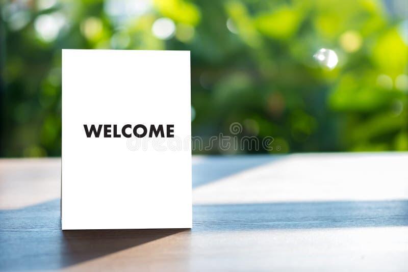 Öppen välkomnande för VÄLKOMMEN begreppskommunikationsaffär till laget arkivfoton