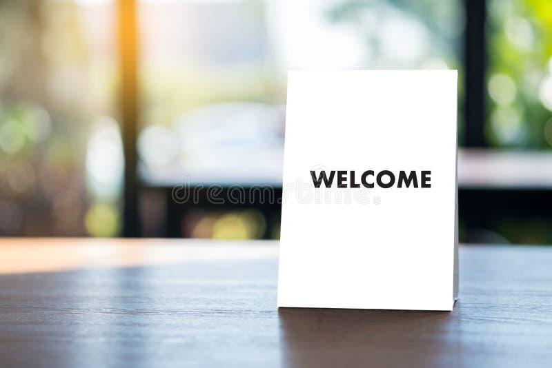 Öppen välkomnande för VÄLKOMMEN begreppskommunikationsaffär till laget royaltyfri fotografi