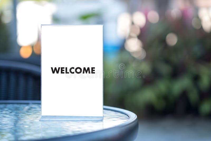 Öppen välkomnande för VÄLKOMMEN begreppskommunikationsaffär till laget arkivbild